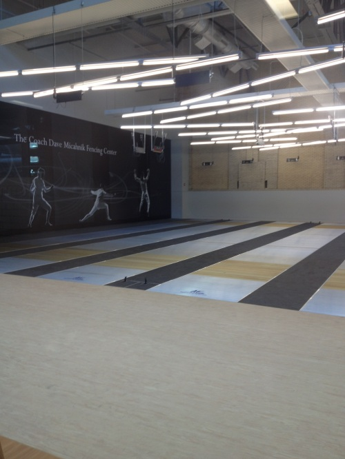 The new fencing training room was named after longtime coach Dave Micahnik.